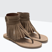 Fringed leather sandals