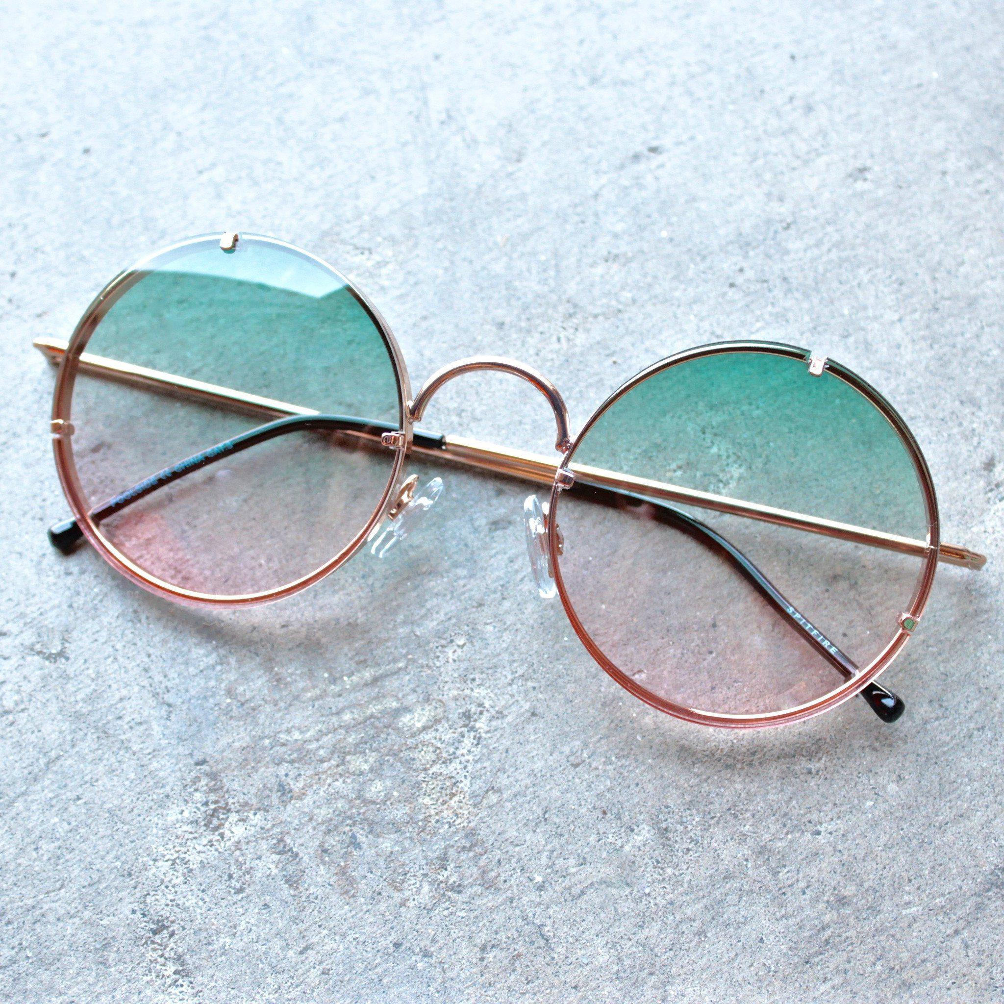 Image of spitfire poolside in gold & blue / pink gradient round sunglasses