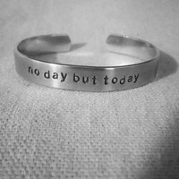 No day but today: hand stamped aluminum RENT cuff by fandomoniumdesigns