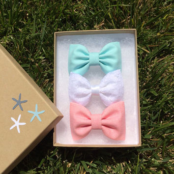 Aqua, pink chambray, and white lace hair bows from seaside sparrow.  Seaside Sparrow bows make the perfect birthday gift.