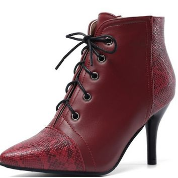 The new style pointy lace-up combines simple color with thin, high-heeled Martin boots shoes