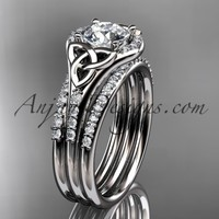 """platinum diamond celtic trinity knot wedding ring, engagement ring with a """"Forever Brilliant"""" Moissanite center stone and double matching band CT7126S"""
