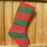 Red and green stripe Christmas Stocking with holly
