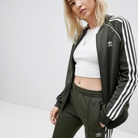 adidas Originals Three Stripe Track Jacket & Pants In Khaki at asos.com