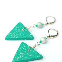 Long dangling modern art inspired turquoise boho earrings.