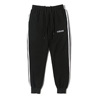 ADIDAS sells fashionable casual men's and women's striped pants