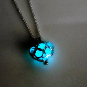 Glow in the dark poisoned heart necklace by AraMarie on Etsy