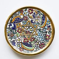 Profiled decoration plate and hand-made enameled antique Arabic and Renaissance formulas. Painted with 24 kt gold on fire.