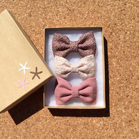 Textured mauve, winter white, and mauve hair bows from seaside sparrow.