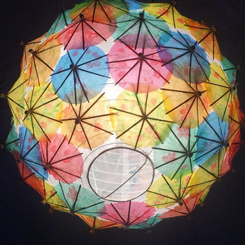 Brightly coloured hanging lightshade made with cocktail umbrellas