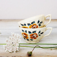 Two vintage coffee cups, Delicate Digoin Sarreguemines cups with floral decoration, Tea party, 1920