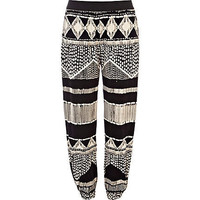 Black and white aztec print jogger trousers