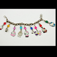 Hello Kitty Inspired Charm bracelet, Tibetan Silver Charms on stainless steel Chain CUTE