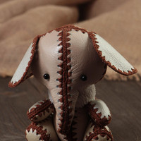 Handmade small beige leather soft toy elephant stitched with brown threads