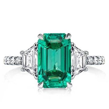 The Charrolton, A Stunning Emerald Green & White Sapphire Three Stone Engagement Ring