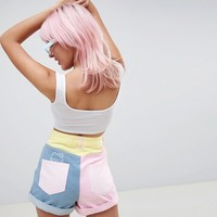 Hello Kitty x ASOS DESIGN colour block denim shorts with embroidery detail at asos.com