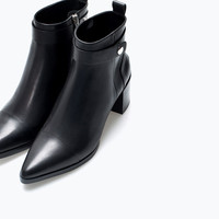 High heeled pointed leather bootie