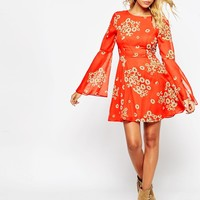 ASOS Fluted Sleeve Dress with V-Back in Red Daisy Print at asos.com