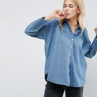 ASOS Denim Shirt With Batwing Sleeve in Mid Blue Wash at asos.com