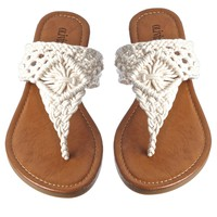 This nautical look flip on style flat sandal features a crochet embellishment t-strap thong vamp, and a smooth seamless no-skip sole, Padded footbed, low heel. Wear with maxi skirts, dresses, shorts.