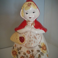 1940s Hull Ware Little Red Riding Hood cookie jar with yellow roses and gold details, open basket #967 with collectors guide
