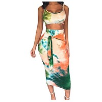 Two-piece suit with long skirt in printed vest