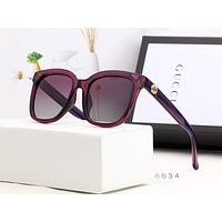 GUCCI fashion hit with women's striped casual sunglasses