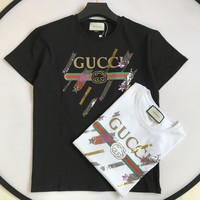 Gucci logo T-shirt with shooting stars