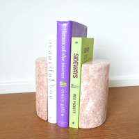 Large pink marble half cylinder bookends