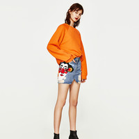 RIPPED DENIM MINI SKIRT WITH JAPANESE DESIGN DETAILS