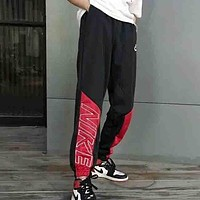 NIKE Fashion new embroidery letter couple splice sports leisure pants trousers Black red