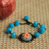 Bracelet: salmon colored rose cabochon with faceted turquoise glass beads, antique brass chain, perfect gift for her, mother's day gift