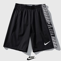 NIKE Summer New Letter Hook Print Women Men Hit Color Shorts