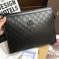 GG solid color embossed letters ladies cosmetic bag clutch