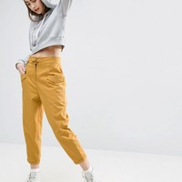 ASOS High Waisted Peg Pants with Buckle Front at asos.com