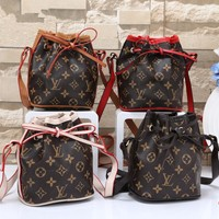 """Louis Vutitton"" Retro Casual Fashion Classic Letter Print Backpack Large Capacity Travel Double Shoulder Bag"