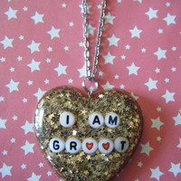 I am Groot Guardians of the Galaxy inspired hand cast gold star and glitter filled resin fandom heart pendant necklace