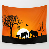 Elephant silhouettes at sunset Wall Tapestry by Laureenr