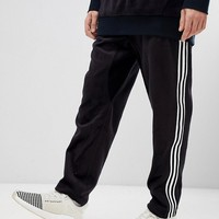 adidas Originals adicolor Velour Joggers In Tapered Fit In Black CY3544 at asos.com