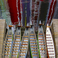 Outrigger Canoe Boats And Water Reflection by Ben and Raisa Gertsberg