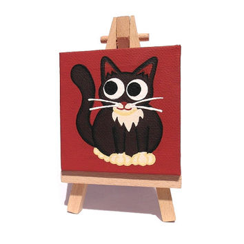 Black and White Cat Miniature Art - small acrylic painting of a cute cartoon cat on a dark red background, mini canvas with easel or hanging