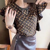 Louis Vuitton LV fashion loose old flower pattern T-shirt foam printing women