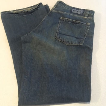 Vintage Men's Levis, Signature Levi Strauss Men's Low Bootcut Jeans, 34 x 32 Dark Wash Jeans, 100 % Cotton, Made in Cambodia, Distressed Hem
