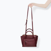 Leather city bag with front pocket