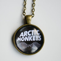 Various Arctic Monkeys Glass Dome Pendant Designs With Antique Gold Chain Or Black Necklace Chord