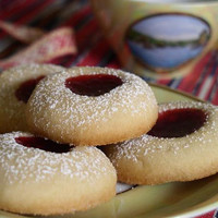 Homemade Swedish Vanilla Cookies with jam, grapes, strawberries, orange or raspberry with powder white sugar