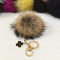 Fur pom pom keychain, bag pendant with flower charm in duo natural no dye color tone