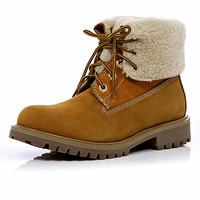 Light brown shearling lined worker boots