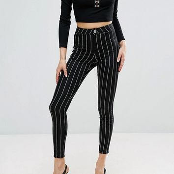 ASOS RIVINGTON High Waisted Denim Jegging in Clean Black Stripe with Welt at asos.com
