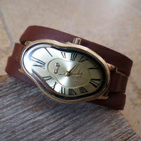 Women's watch inspired by Salvador Dali. Brown Leather Strap Gold Face